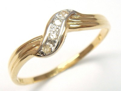 Genuine Diamond 9K Yellow Gold Ring.