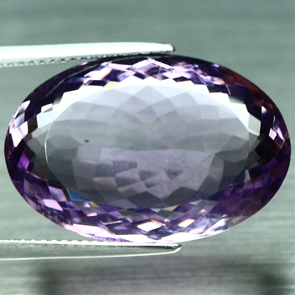 25.53ct. Natural oval facet Purple Amethyst