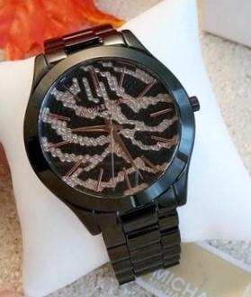 Never worn Michael Kors Couture quartz bracelet watch.