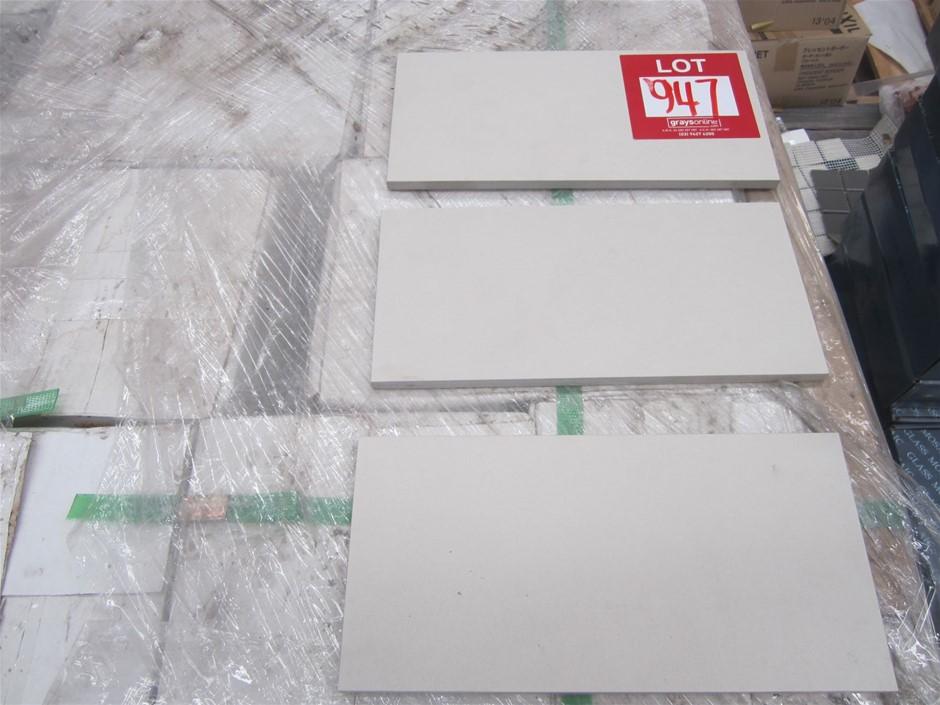 """10 boxes of """"Cotton"""" coloured porcelain tiles."""