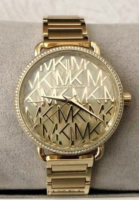 Ladies new Michael Kors NY Couture beautiful 'MK' gold plated watch.