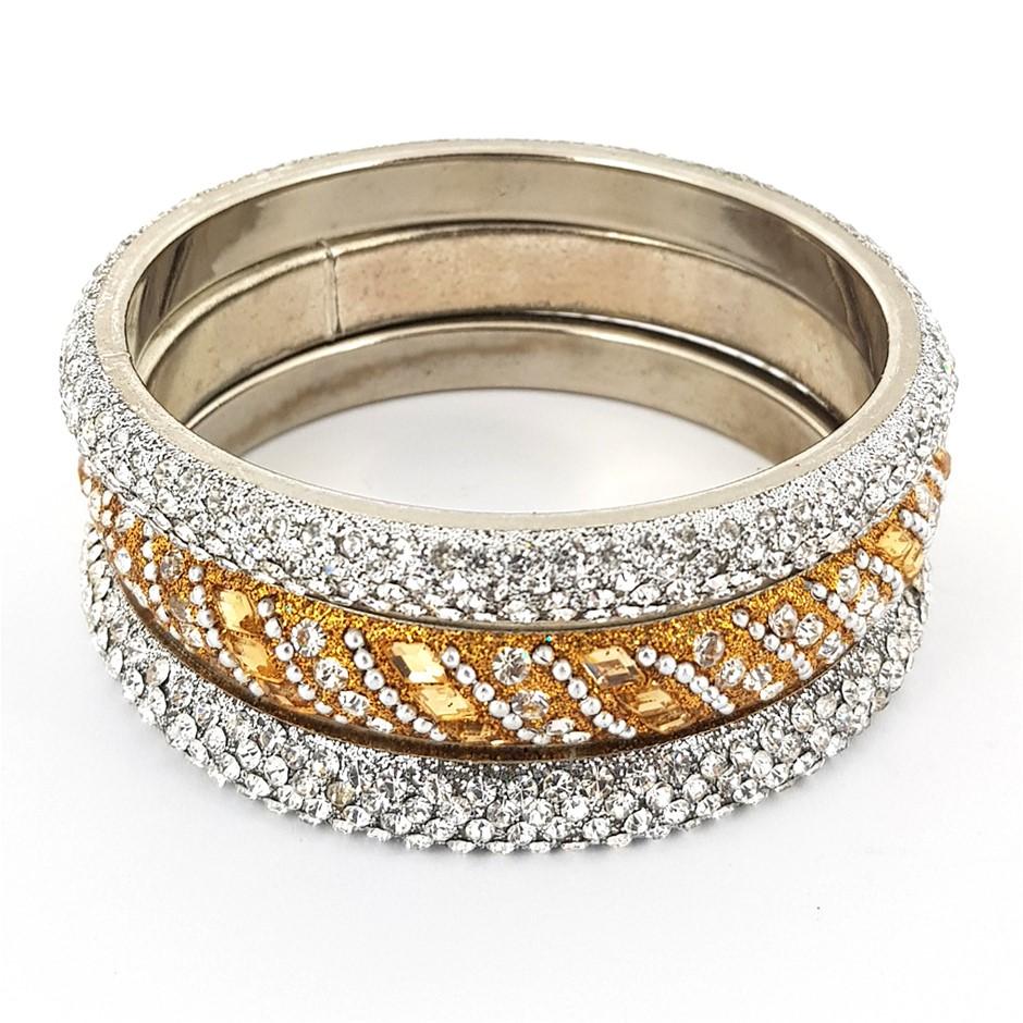 Three Gold & White Crystal Bangles.