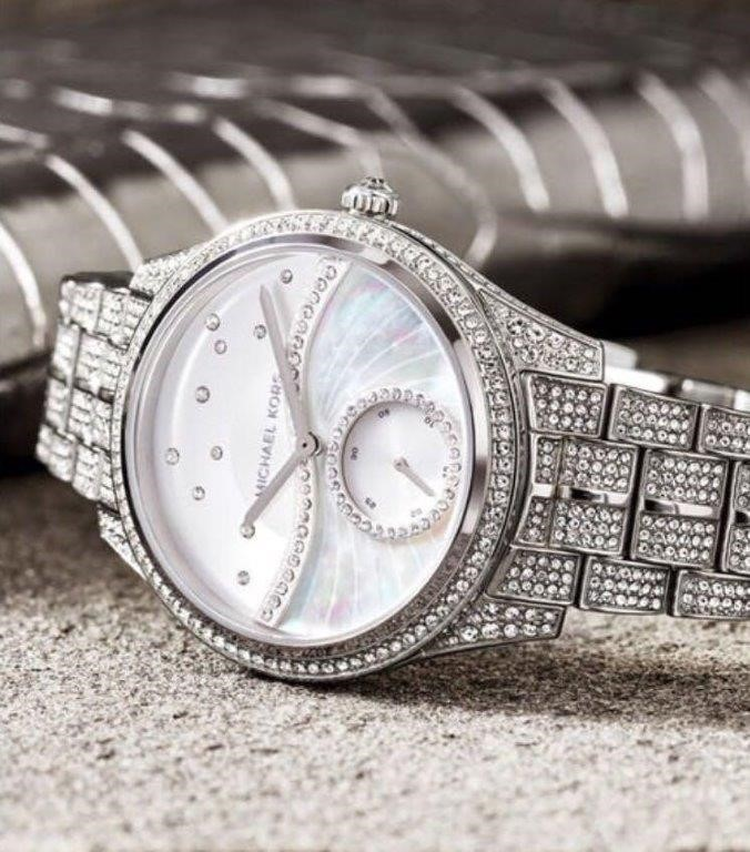 Ladies new Michael Kors Lauryn watch with amazing 'wave' dial.