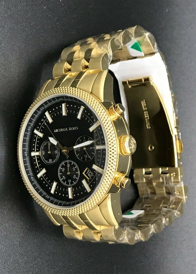 Mens unworn Michael Kors Couture NY classy gold plated mens watch.
