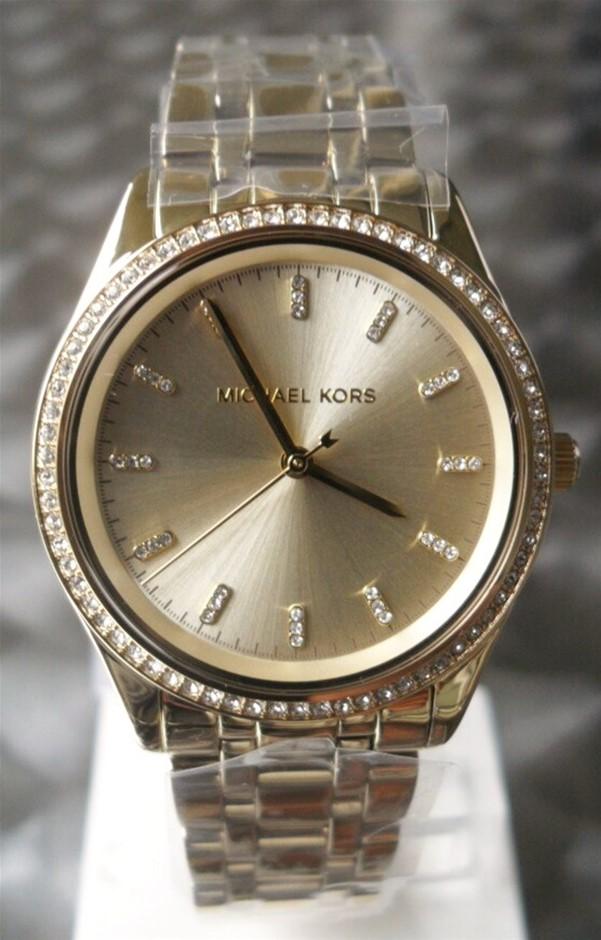Ladies new Michael Kors Couture NY classic, feminine & classy watch.