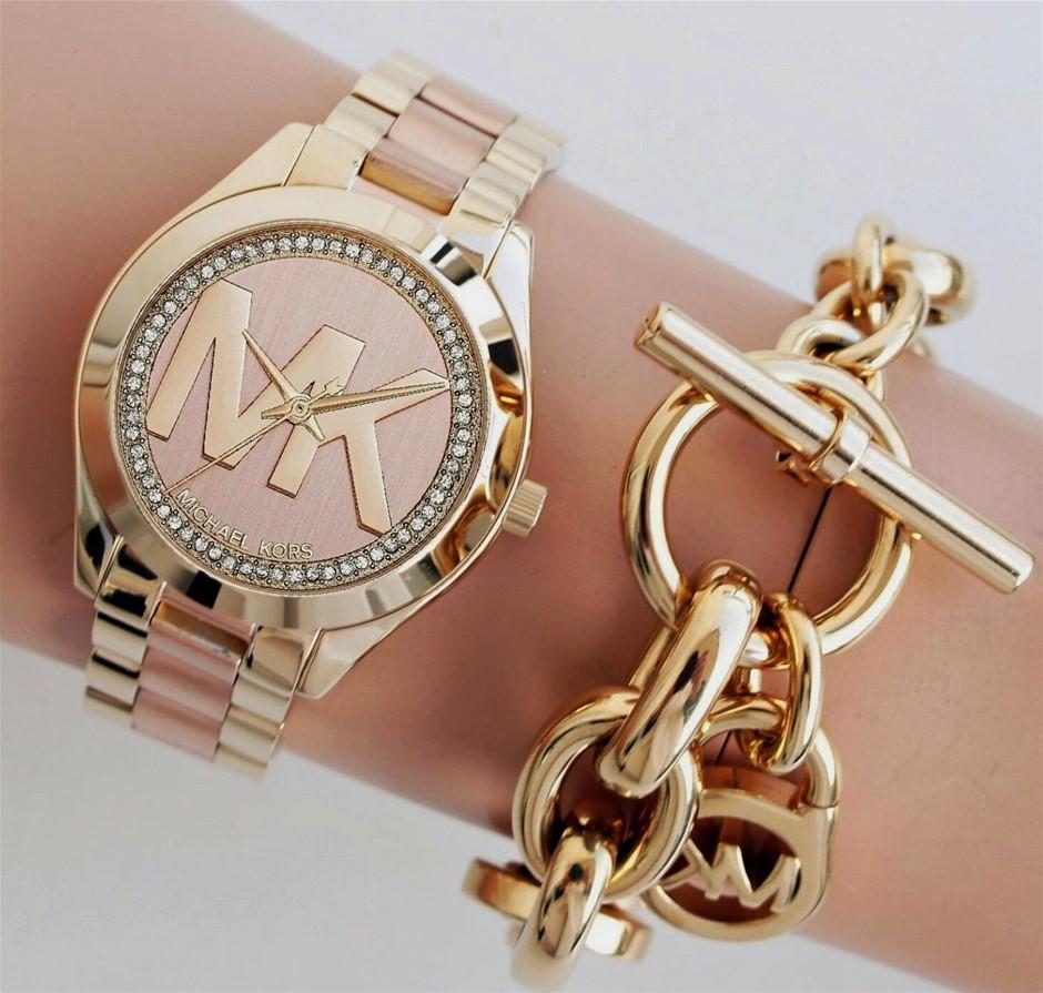 New Michael Kors 'Runway' signature MK rose gold watch.