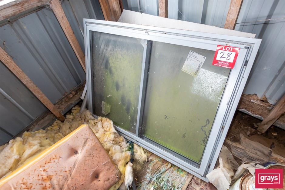 Alloy Sliding Window in Timber Frame